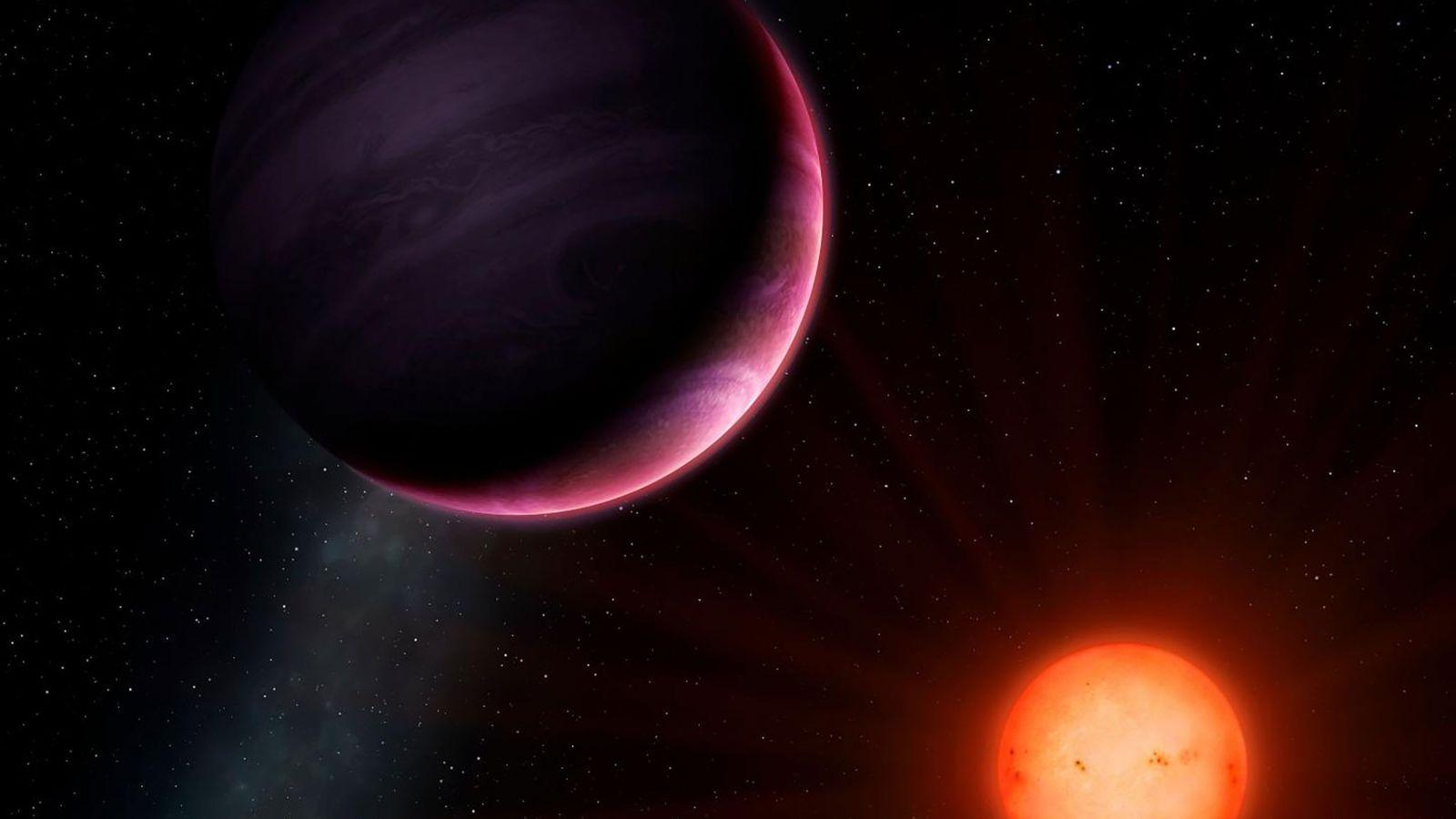 Cette illustration représente NGTS-1b, une planète tout juste découverte qui orbite autour d'une étoile étonnamment petite, ...