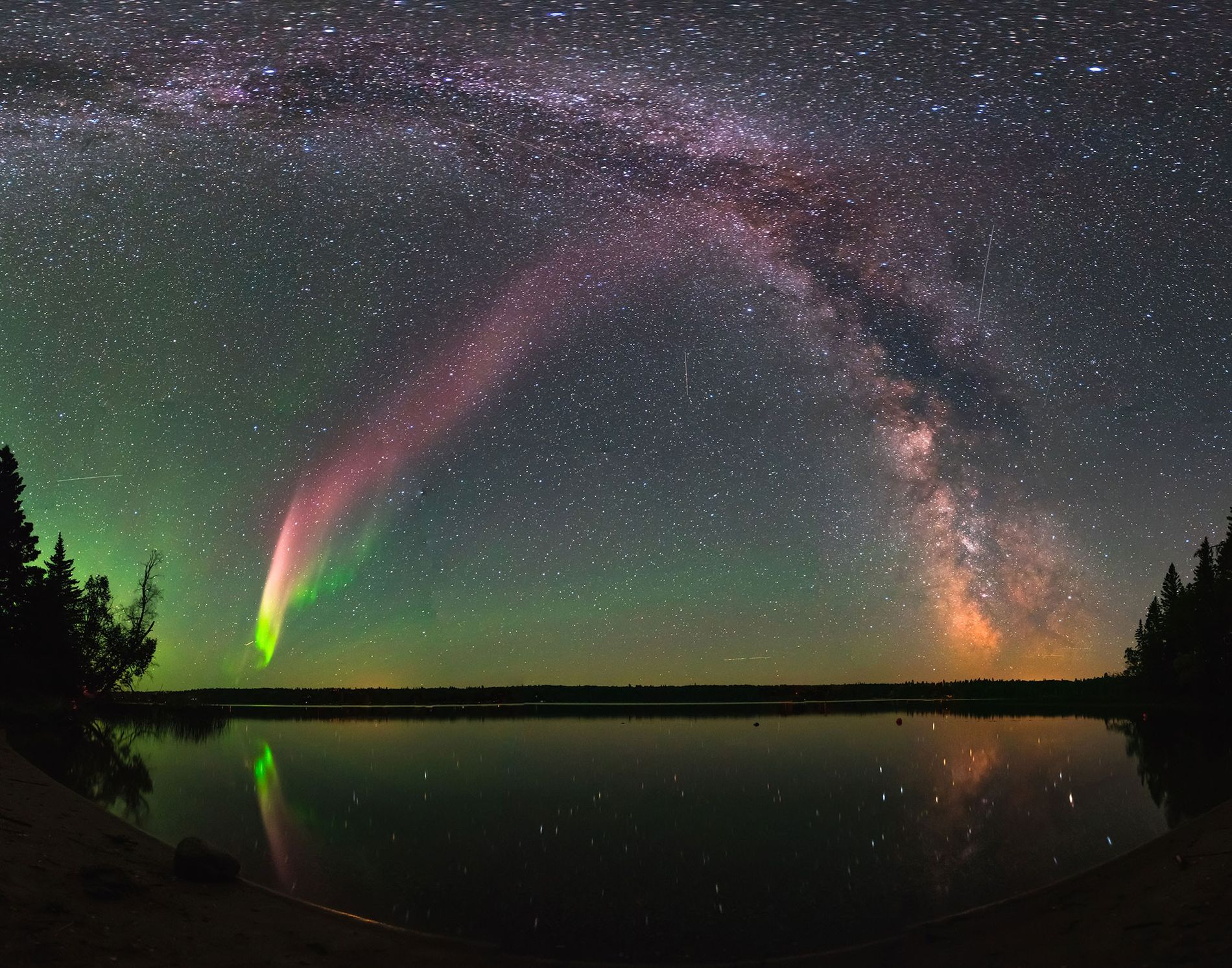 Steve seen with the Milky Way over Childs Lake, Manitoba.  ...