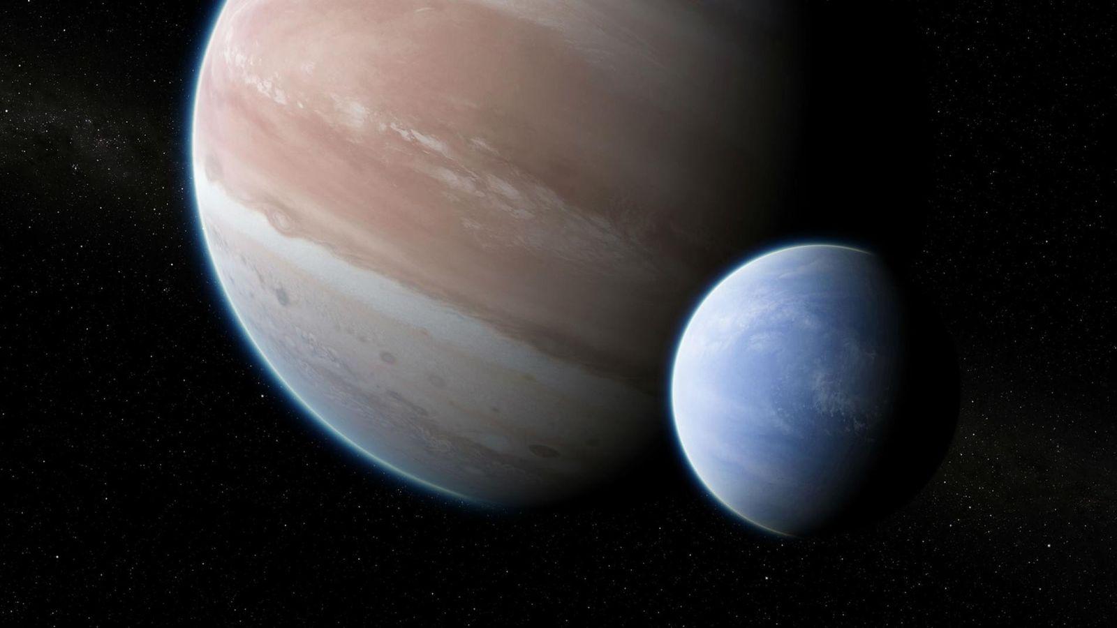 Illustration d'une lune orbitant autour de la planète Kepler-1625b, grande comme Jupiter.