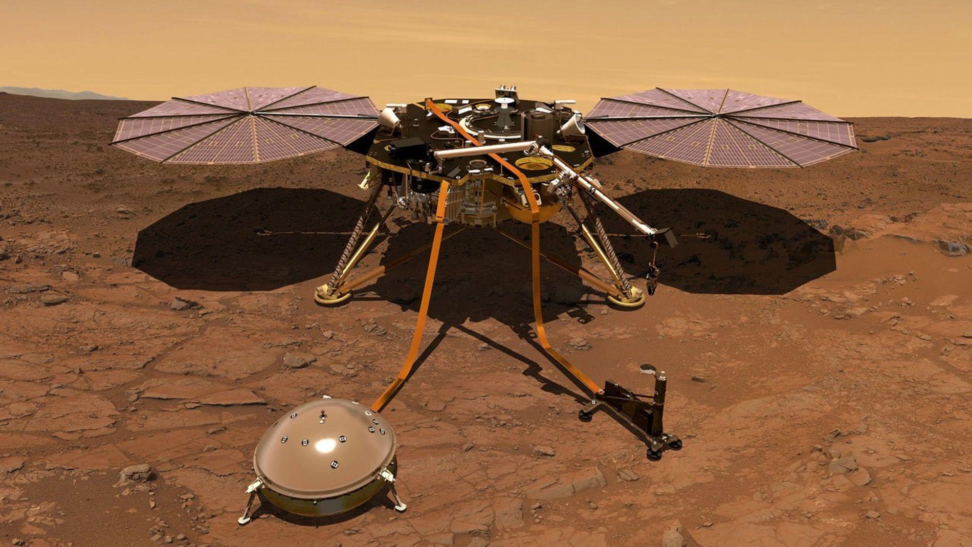Cette illustration représente l'atterrisseur InSight sur la surface de Mars. Les premières données communiquées par le ...