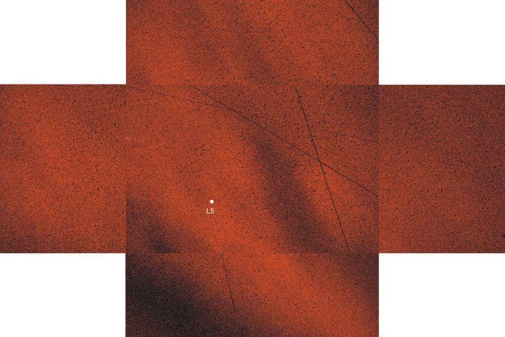 La lumière polarisée qui entoure le point de Lagrange 5 (point blanc) a aidé à révéler ...