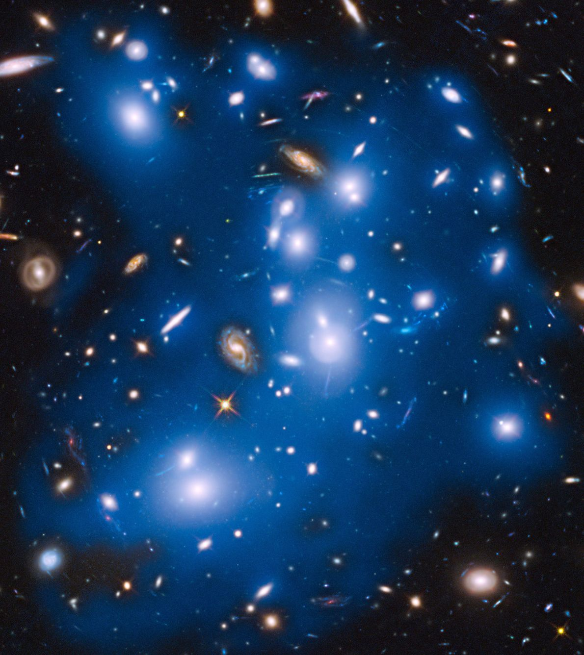 NASA's Hubble Space Telescope has picked up the faint, ghostly glow of stars ejected from ancient ...