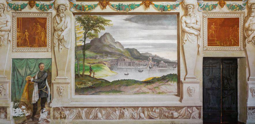 En s'approchant de Rhodes, le Colosse - ici représenté avec les jambes écartées - aurait été visible de loin, une scène imaginée par Gualtiero Padovano dans cette fresque du 16e siècle. Villa Godi Malinverni, Lugo di Vicenza
