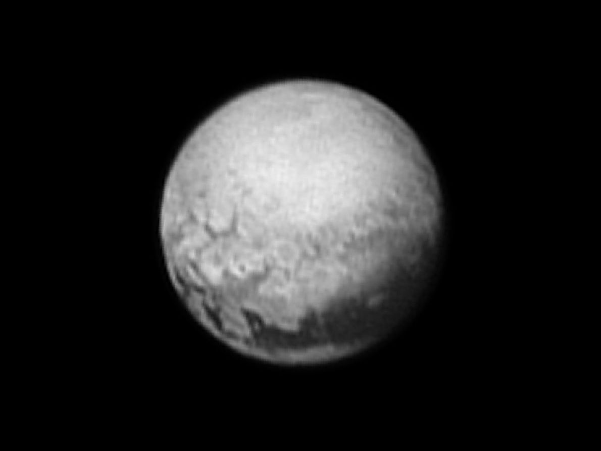 """Taken July 9, 2015, this black-and-white view of Pluto shows the """"tail"""" of an immense black ..."""