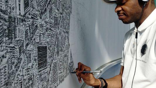 Un artiste dessine les plans d'une ville de mémoire