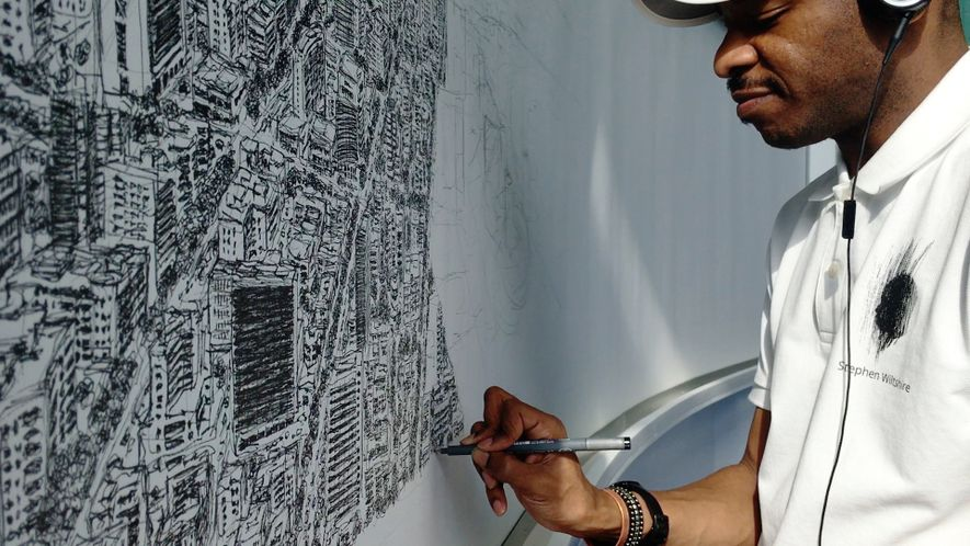 Un artiste dessine les plans d'une ville de mémoire NEO