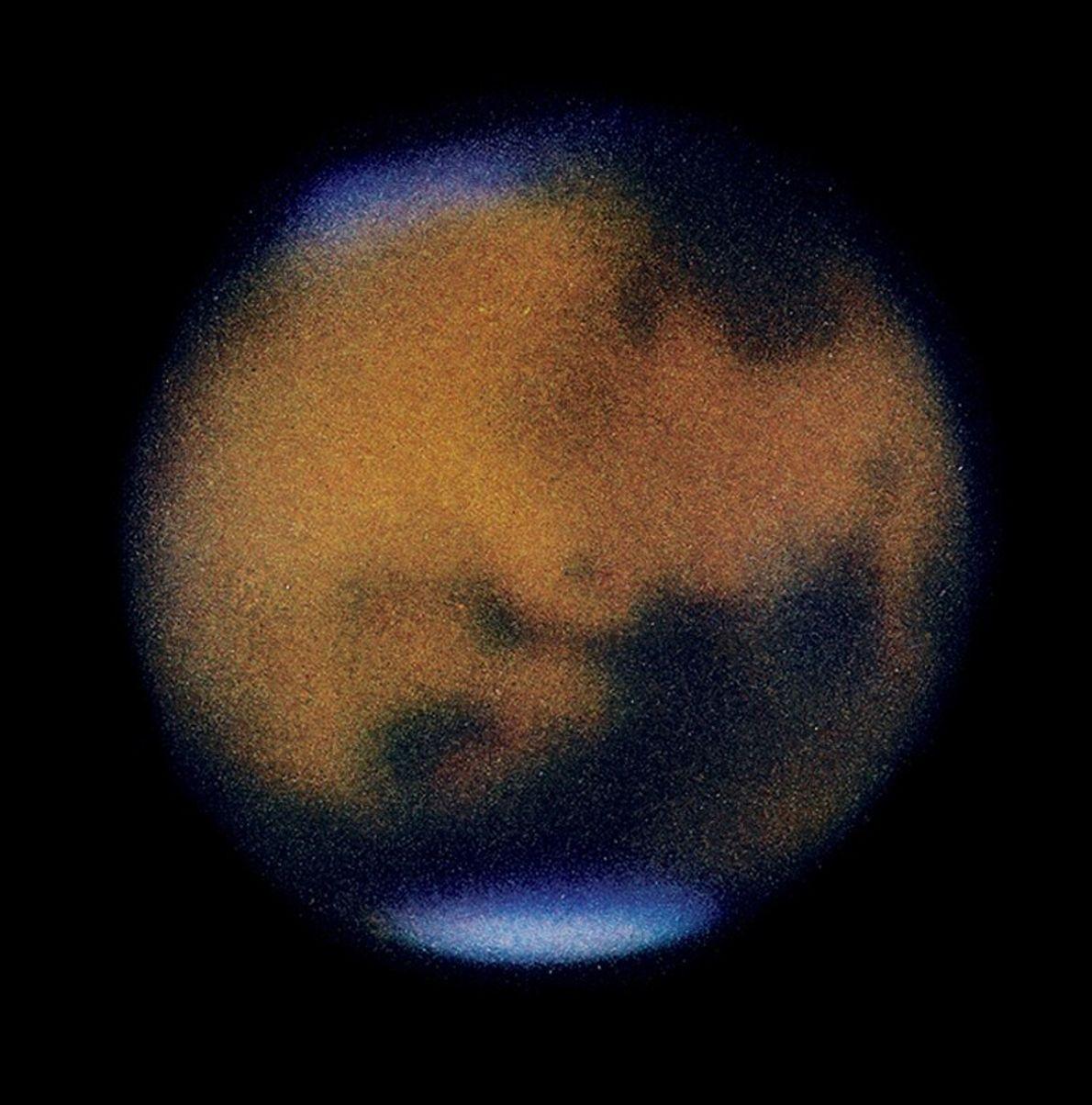 1954 : Mars en couleurs  L'astronome E.C. Slipher a pris ce cliché depuis l'Afrique du Sud. Il l'a publié ...