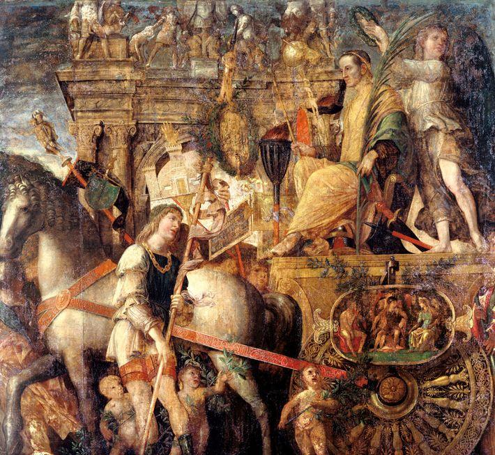 Recevant sa couronne de laurier, Jules César traverse Rome dans son char de triomphe dans ce ...