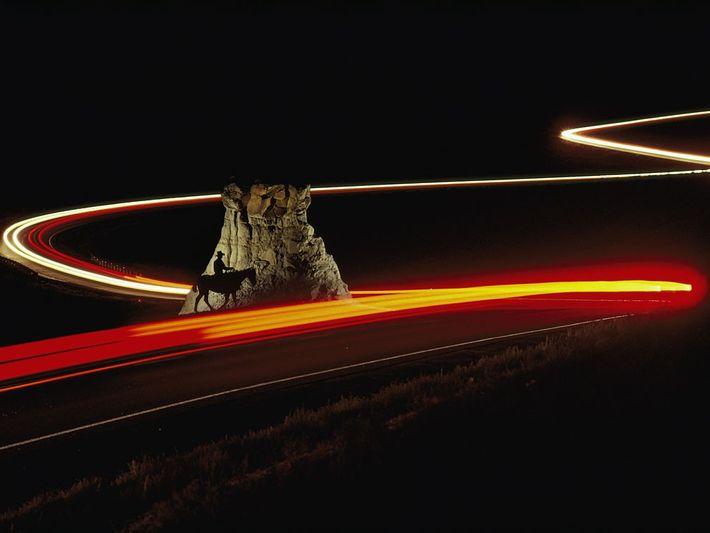 Cowboy et voitures, Badlands, États-Unis