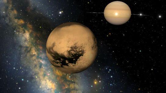 Cette vue simulée montre la lune géante Titan et sa planète, Saturne, ainsi que les lunes ...