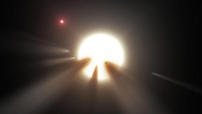 Illustration montrant une comète passant devant l'étoile de Tabby, autre hypothèse émise pour expliquer les variations ...