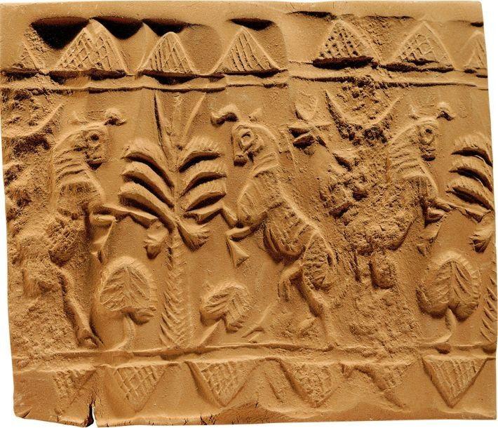 Ce sceau-cylindre babylonien (entre 1595 et 1200 avant J.-C.) représente des taureaux et des arbres. Musée ...