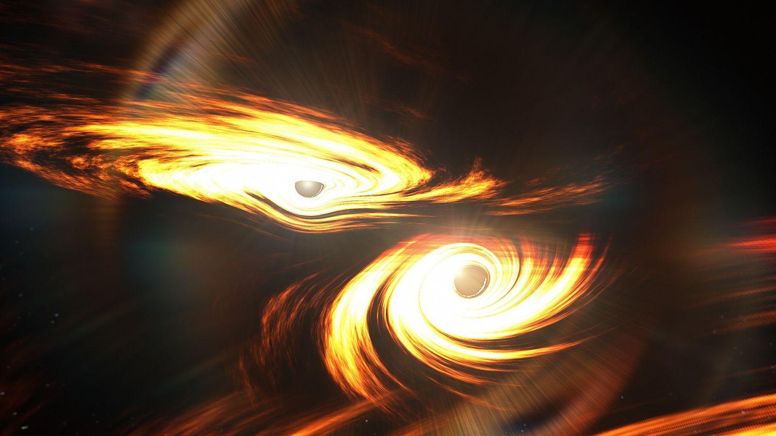 Vue d'artiste de deux trous noirs sur le point d'entrer en collision.On ne sait pas encore ...