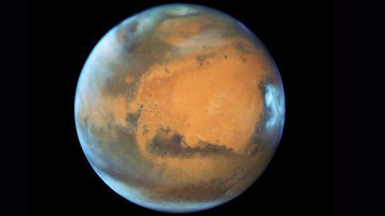 En 2003, le télescope spatial Hubble a pris cette photo de la planète rouge 11 heures ...