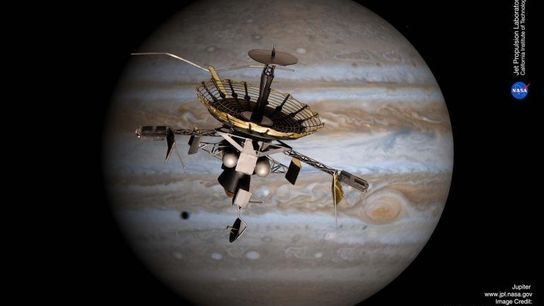 Satellite de la flotte Galileo survolant Jupiter.