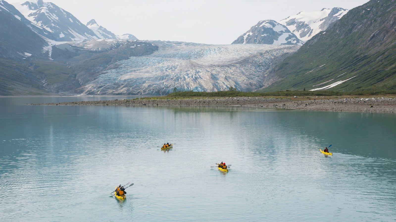 People kayaking with Reid Glacier in background, Glacier Bay