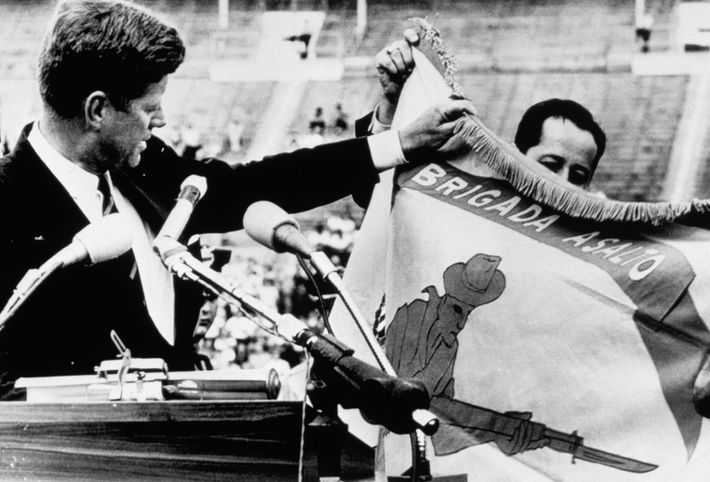 Kennedy Holding Flag of Cuban Exiles