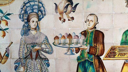 Sur ce carrelage valencien du 18e siècle, on voit un serveur en veste marron qui porte ...