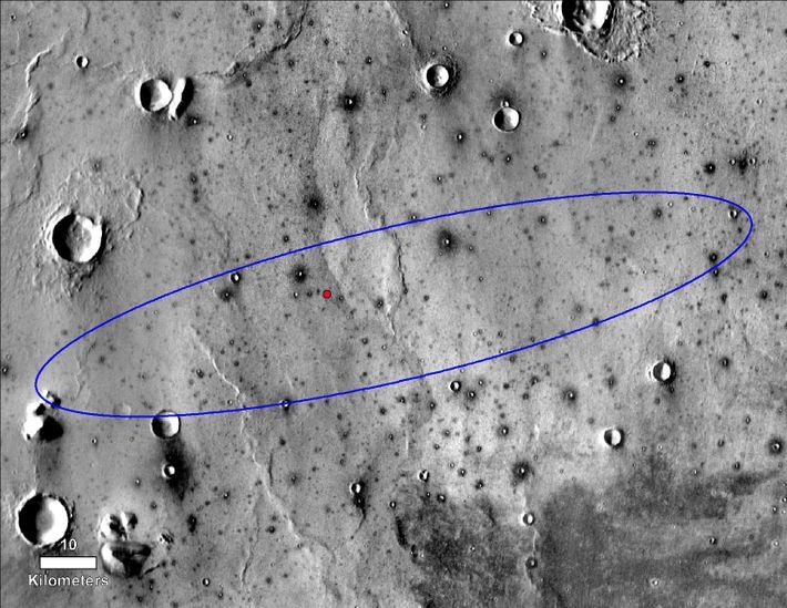 Le point rouge marque l'emplacement final de l'atterrisseur InSight de la NASA au sein d'Elysium Planitia, ...