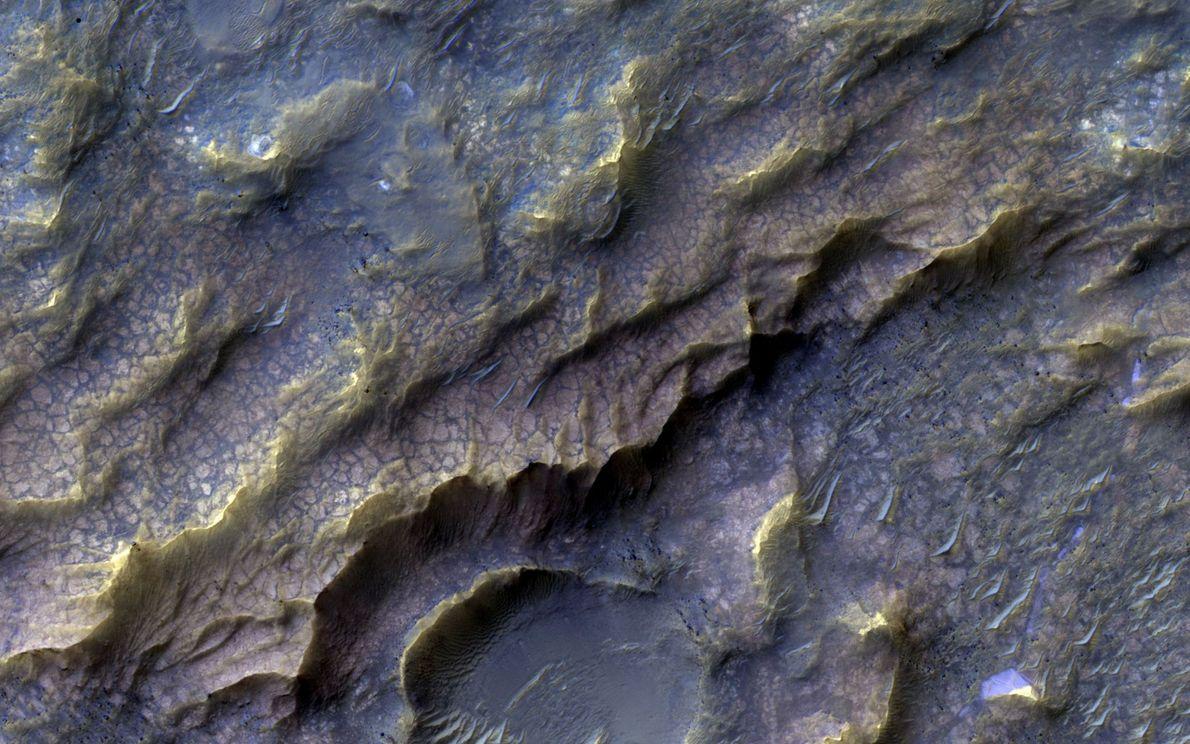 Cette texture rosâtre est un signe d'érosion à la surface de Mars et l'altération causée par ...