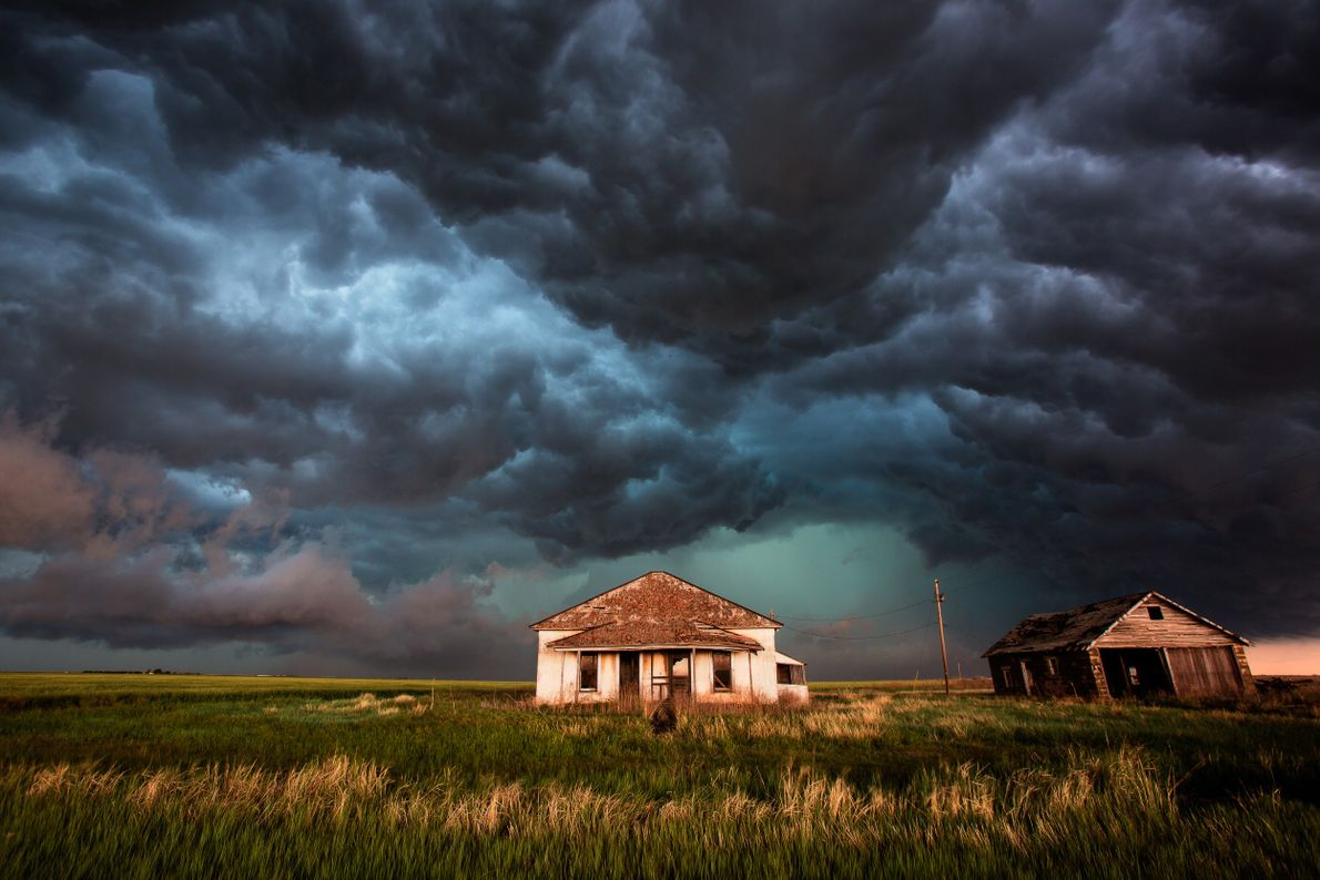 An oceanic shelf cloud passes over Texas farmlands, leaving low-hanging clouds in its wake.
