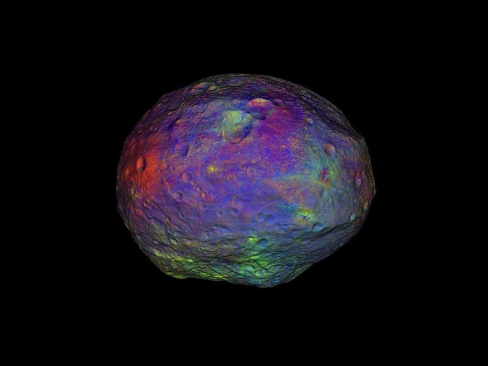 L'astéroïde Vesta. Chaque couleur de sa surface correspond à différentes compositions minérales.